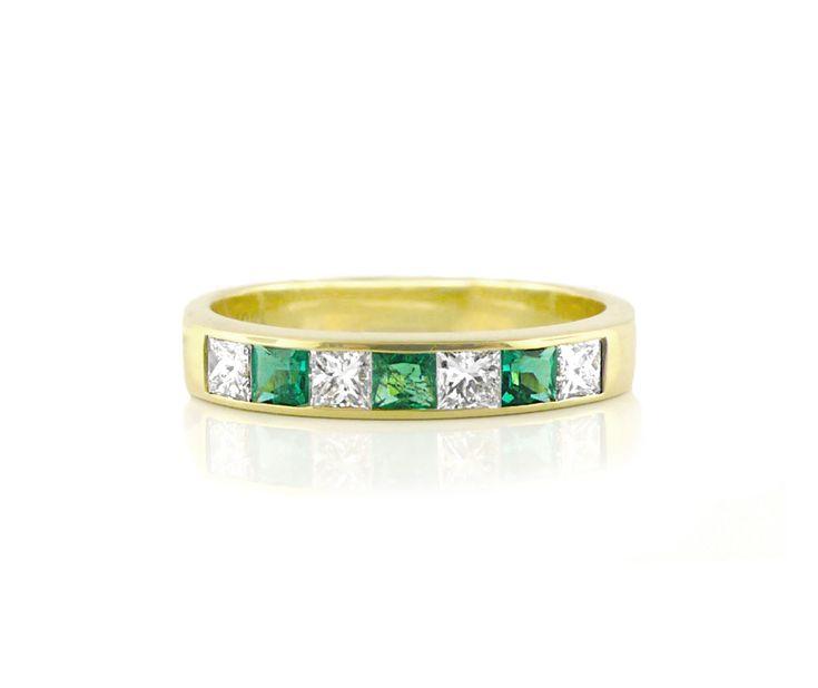 An 18ct Yellow Gold, Diamond and Tsavorite Eternity Ring