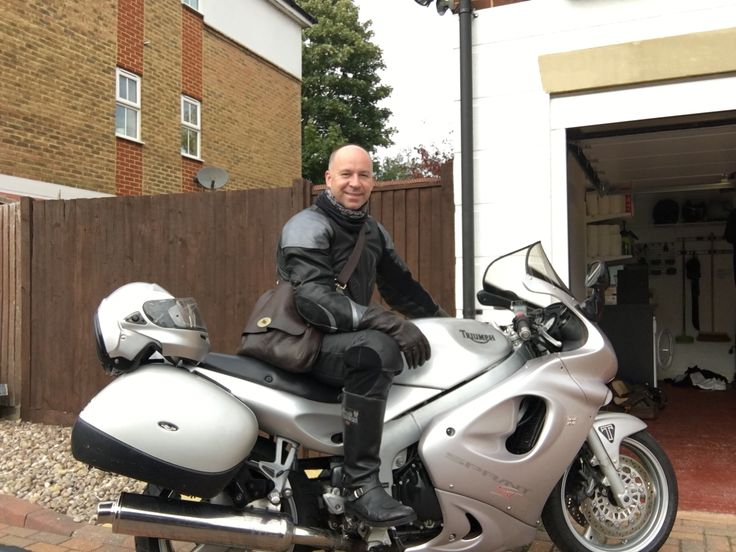 Triumph Sprint ST 955i, rider in Daytona one piece leather suit, vintage Frank Wright  boots and leather gauntlets