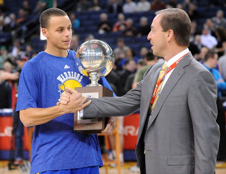 Description of . Golden State Warriors' Stephen Curry is congratulated by Golden State Warriors co-owner Joe Lacob after Curry received the 2011 NBA All-Star Weekend Skills Challenge Hometown Trophy  in Oakland, Calif., on Tuesday, Feb. 22, 2011. (Doug Duran/Staff)