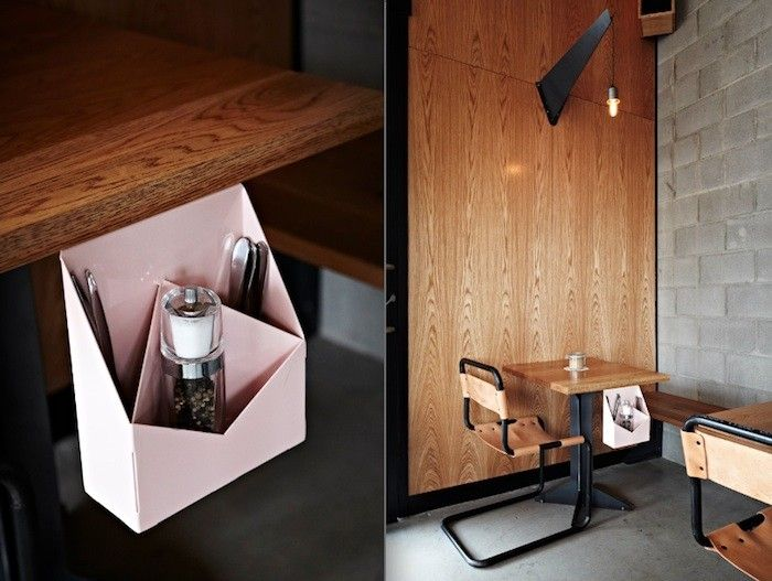 Commercial restaurant with bench seating, CMU walls and utensil holder detail.