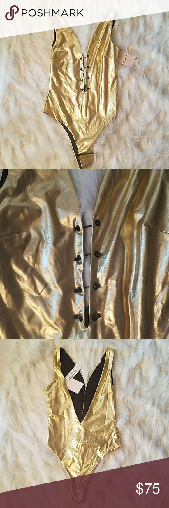 SHOWNY gold bodysuit Metallic gold. Barbell laces down the front Nasty Gal Tops