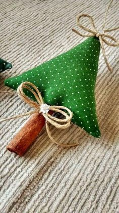 Fabric Christmas tree with cinnamon stick trunk.
