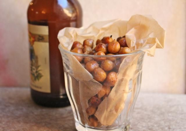 A recipe for Tamari-Roasted Chickpeas, made with canned chickpeas, tamari soy sauce, maple syrup, and spices.