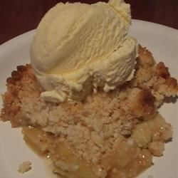 A sweet, crumbly cake mix mixture is spooned over sliced apples and water, and baked in a 9x13-inch pan until the apples are tender and the topping is brown and bubbly.