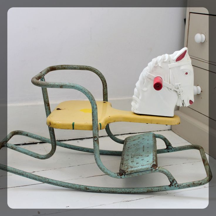 Original 1950's metal rocking chair by British toy company Tri-ang. Fabulous iconic design that would look great in any playroom. It's showing some signs of it's old age, but is a really charming piece and very collectable. Fact of the day: Tri-ang toys was formed by the Lines brothers - William, Walter and Arthur Lines. Those 'three Lines' made a triangle, hence the name Tri-ang! Please contact me for a postage quote.