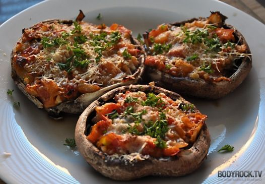 Skinny Pizza: Portobello Mushrooms with Vegetables, Sausage and Shredded Parmesan Cheese.