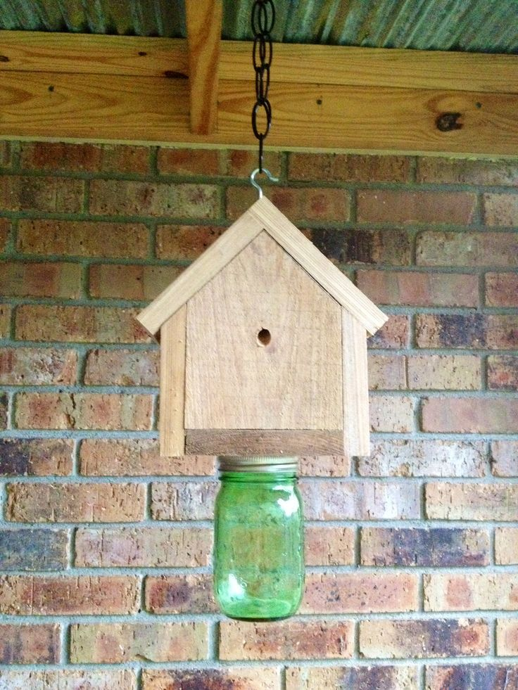 Carpenter Bee Trap made by my neighbor. Do you have a problem with bees boring holes in your wood? Check this out!  Bees go in one of the small holes, which are drilled on an angle. They can't figure out how to get out! The mason jar can be removed to dispose of the bees.