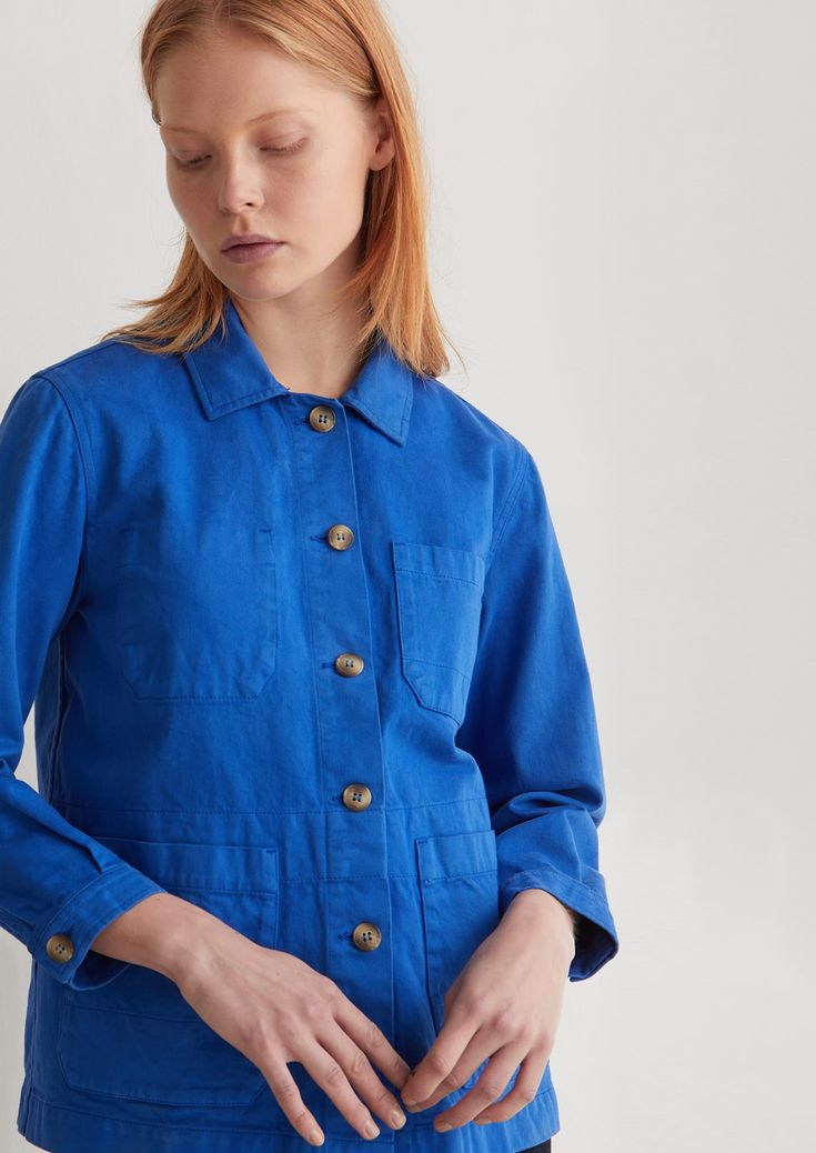 Weighty, garment-dyed cotton twill. Straight cut. Neat, cutaway collar. Three patch pockets, one internal breast pocket. Buttoned cuffs with cotton herringbone taped seams. Topstitching. Imitation horn buttons.