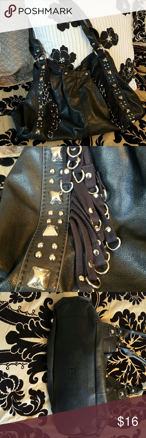 Kathy Van Zeeland fringe purse This black purse is a perfect go to! It's so soft and durable. It has two magnetic clasp parts and the middle zips up. There is spent makeup in one side of the snaps as seen in the picture. Kathy Van Zeeland Bags Shoulder Bags