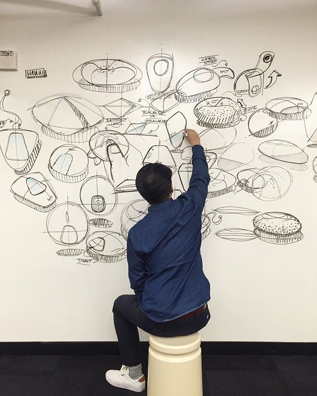 """frog Industrial Designer Ara Arcle on a recent episode of whiteboard sketching. """"It was a late night sketch session and we were hitting a bit of a creative block and decided to go to the whiteboard. With paper and pen, designers can tend to get a bit too detailed with design. But the nice thing about the whiteboard -- with its size and thick lineweights -- the sketches become much more broad, expressive, and gestural. Multiple people can sketch."""