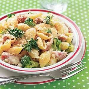 Shell pasta with broccoli and ham topped with parma cheese