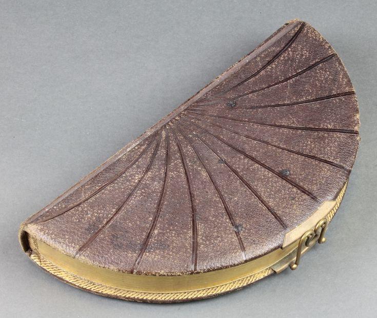 Lot 323, A Victorian leather covered fan shaped photograph album, est £30-60