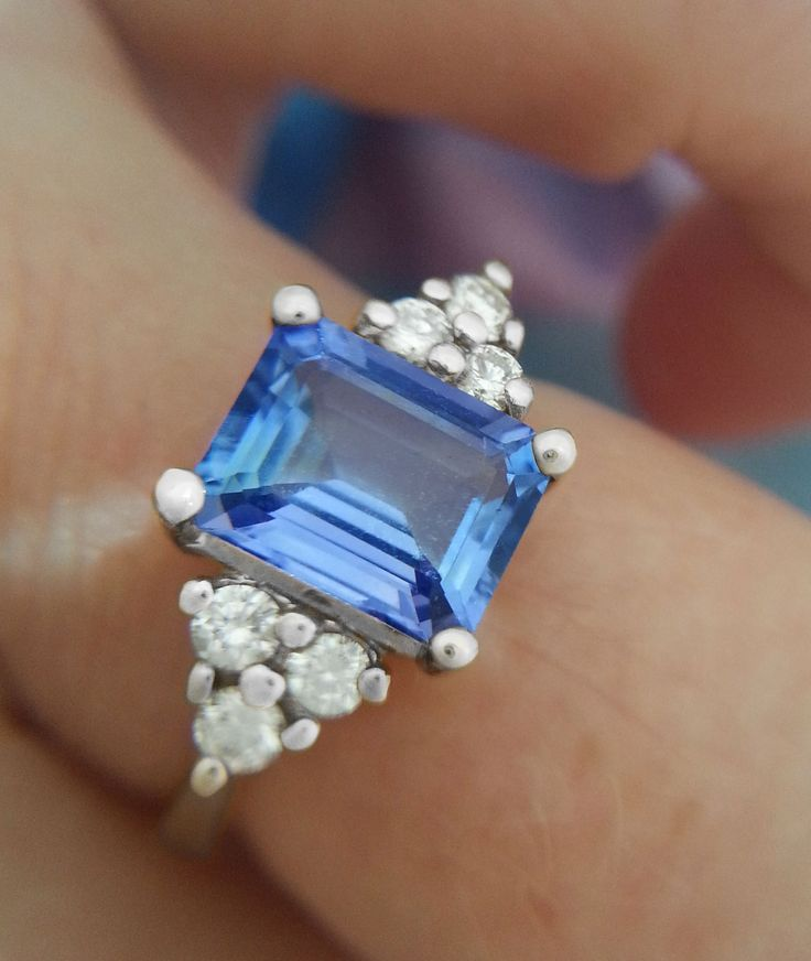 light blue emerald cut sapphire engagement ring beautiful