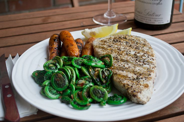 Grilled blue marlin steak with fiddleheads