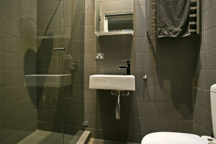 grey tiled ensuite bathroom