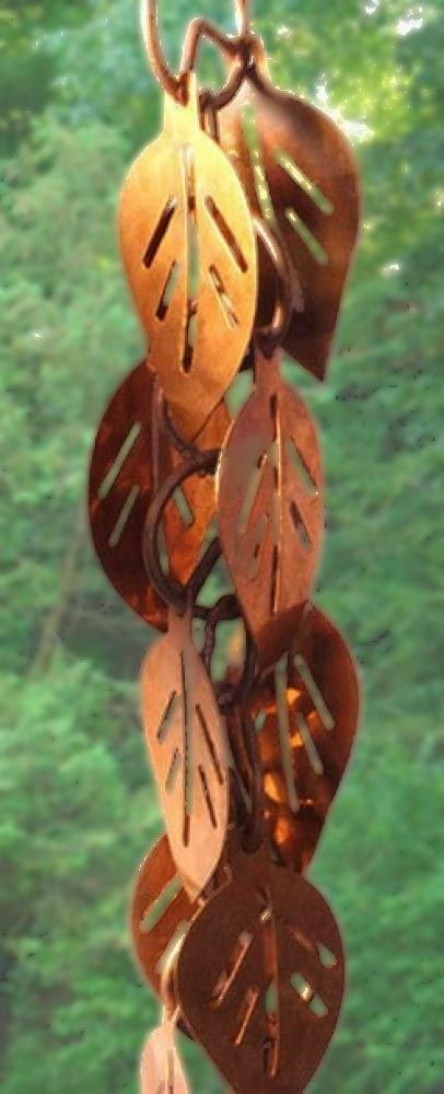 This beautiful 100% pure copper link styleCascading Leaves Rain Chain consists of 92 leaf links measuring 2.6 metres in length. Each leaf is 4 cm wide and7.35 cm long and comes with an attachment piece allowing you to easily connect them to your existing gutter system. As with all of the copper rain chains we sell, they will develop a beautiful rustic patina over time. Note: There is some splashing associated with all rain chains however this style rain chain has more of a splash.