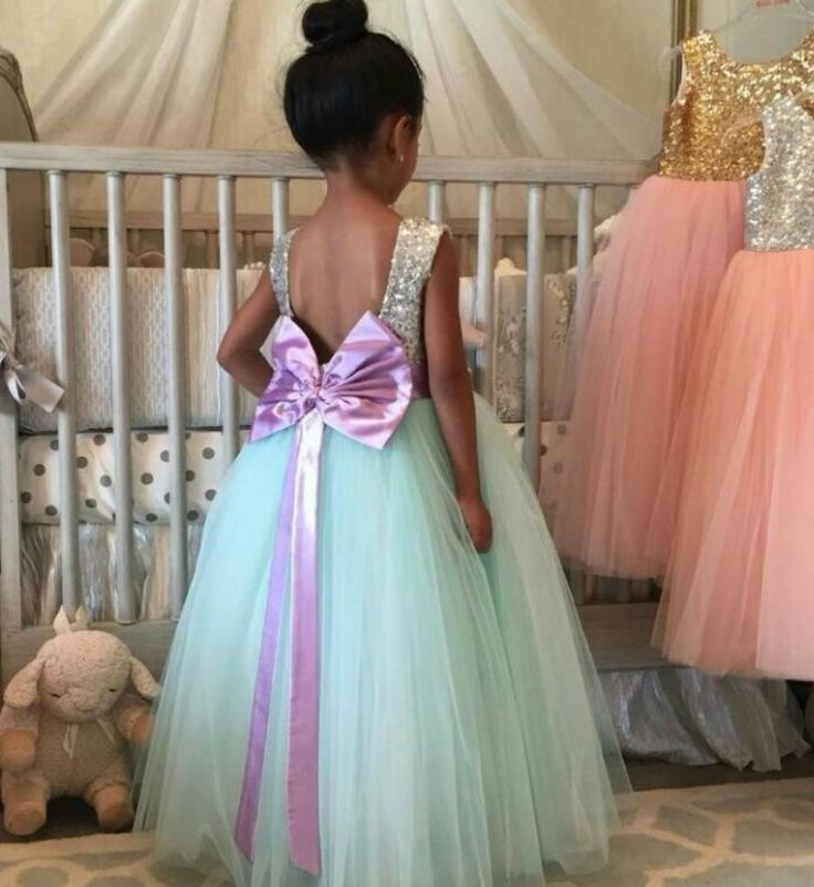Sequin Tutu Gown-Sparkle Silver Sequin Floor Length Big Bow Back Little Girl Tutu Dress Material: Sequin, tulle mesh, satin, cotton Available from 2 - 14 years #littlegirlpartydress #flowergirldresses #littlegirlballgown #sequindress #backlessdress #babygirlbirthdayoutfit