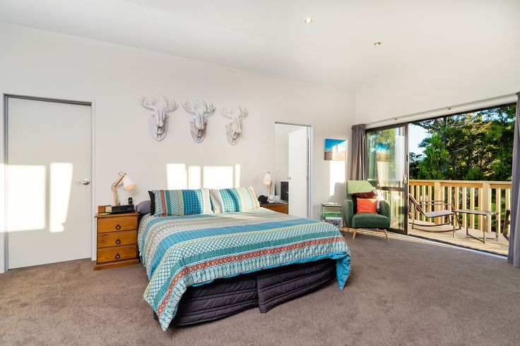 Large bedroom with deck