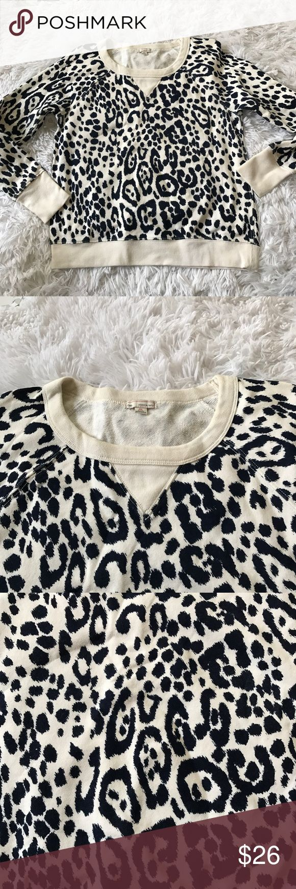 "Gap XS petite pullover Sweater top leopard print Gap  Women's XS petite   long sleeves  100% cotton  Navy blue and white  Leopard print  Great condition  Measurements laying flat:  Armpit to armpit: 19""  Length from armpit: 13.5"" GAP Tops Sweatshirts & Hoodies"