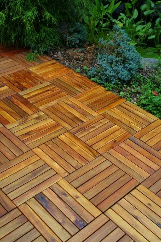 wood tiles for patio- clever idea. (it's weather & termite resistant)