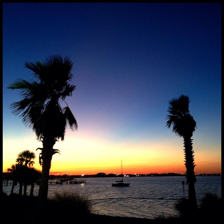 Sundown on the inlet  #pensacolabeach #florida #travel #sundown #palmtrees #boat