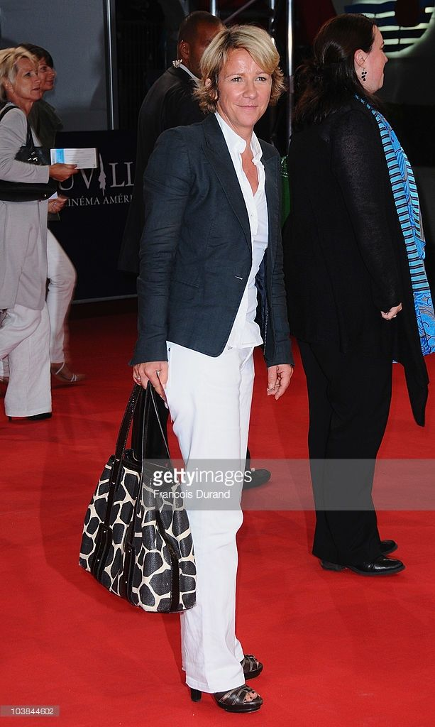 Photo d'actualité : Ariane Massenet poses as she arrives to attend...