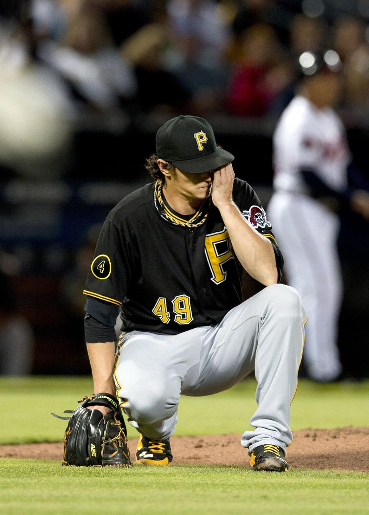 Pittsburgh Pirates starting pitcher Jeff Locke reacts after allowing a base hit to Atlanta Braves pitcher Julio Teheran in the second inning of a baseball game Wednesday, Sept. 24, 2014, in Atlanta. (AP Photo/John Bazemore)