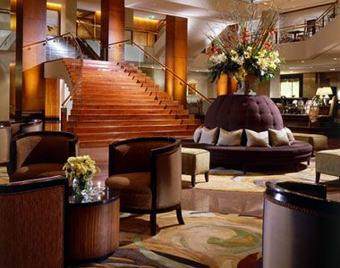 The Four Seasons Sydney - image of Hotel using timber trims, marble floors and plum colour highlights.