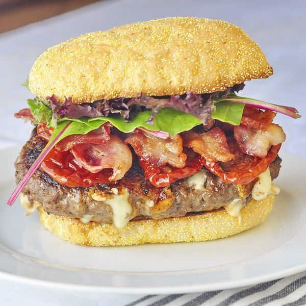 What a burger!! Chipotle Jack Bacon Burgers - grilled burgers are a quick meal summer staple  at our house. These phenomenally flavorful burgers, seasoned with roasted garlic and chipotle and stuffed with melting mini pockets of monterey jack cheese are a particular favorite.