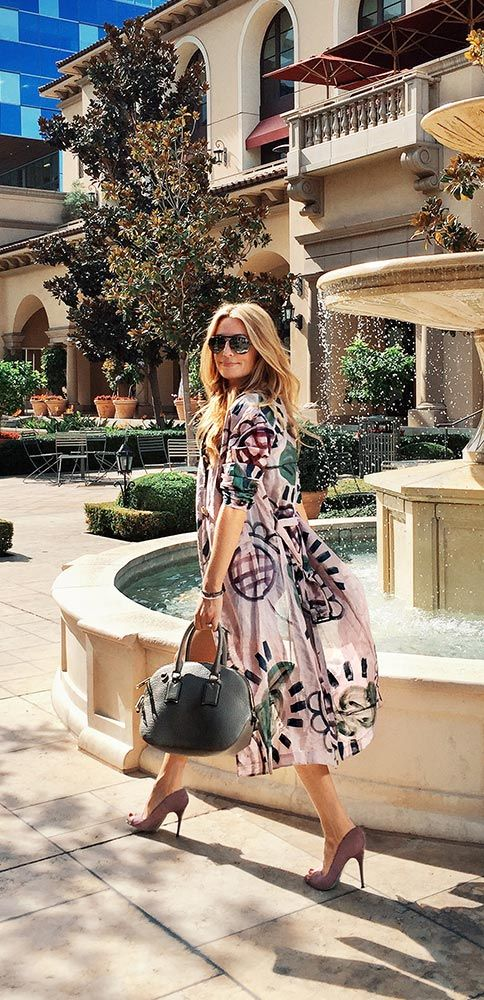 British presenter Cat Deeley wearing a floral Burberry trench coat in Beverly Hills