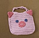 Piggy bib...could be potholder too.  free pattern    www.lionbrand.com
