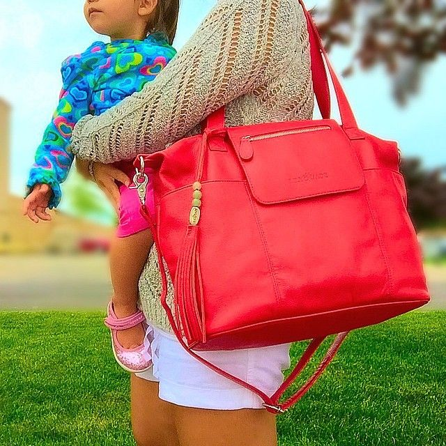 The Madeline in buttery, red leather easily converts to backpack carry. Lily Jade Designer Diaper Bags.