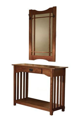 "Powell Mission Oak Console and Mirror by Powell Furniture. $204.99. Hang your coat, hat, and scarves on one of the four hooks of the mirror. Console includes one drawer with Mission style bail. The Mission Oak Console and Mirror are perfect for the entryway. Some assembly required. Oak solids and veneers in warm ""Mission Oak"" finish is reminiscent of the turn of the Century Craftsman Style furniture. The Mission Oak Console and Mirror are perfect for the entryway. Hang you..."