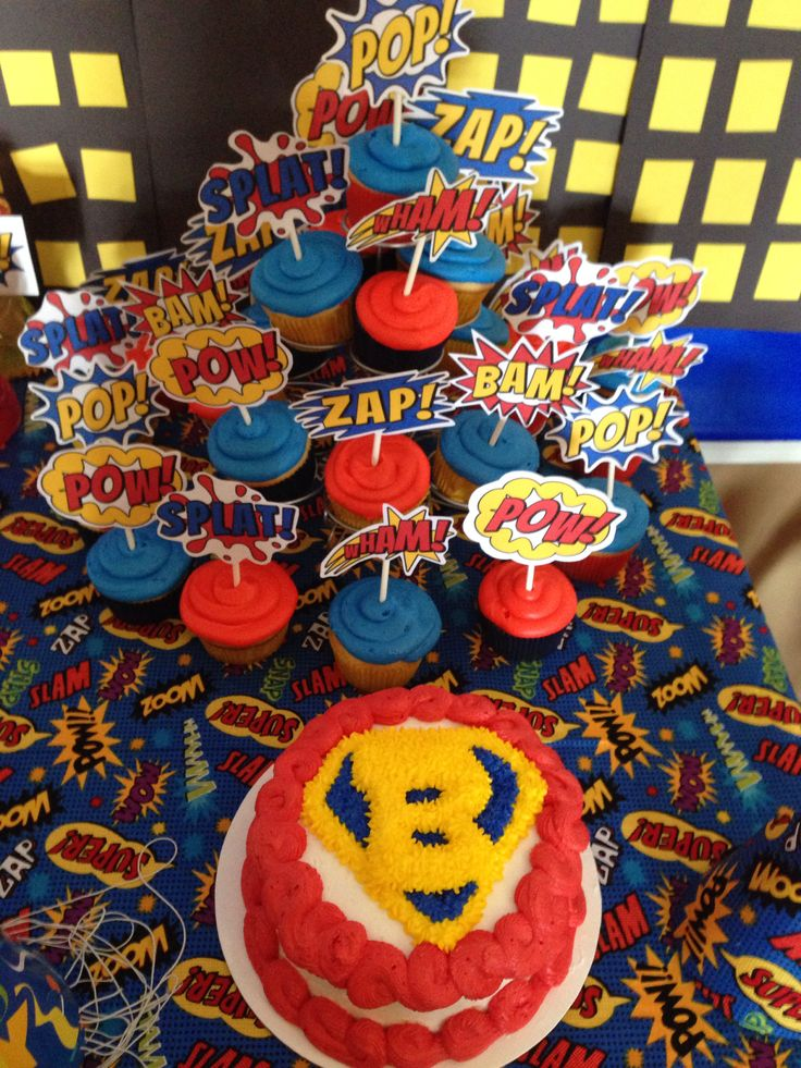 Smash cake and cupcakes with superhero word picks
