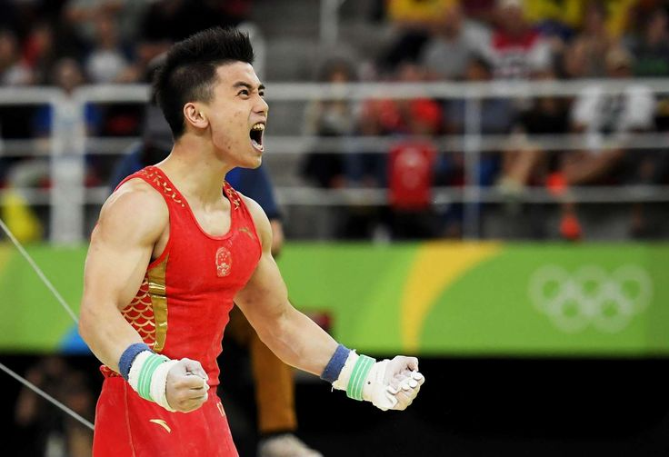 Lin Chaopan of China exults in joy after competing on the horizontal bar during the men's artistic gymnastics team final. China claimed the bronze medal. - Rio Olympics: Highs and lows from Day Three - August 8, 2016