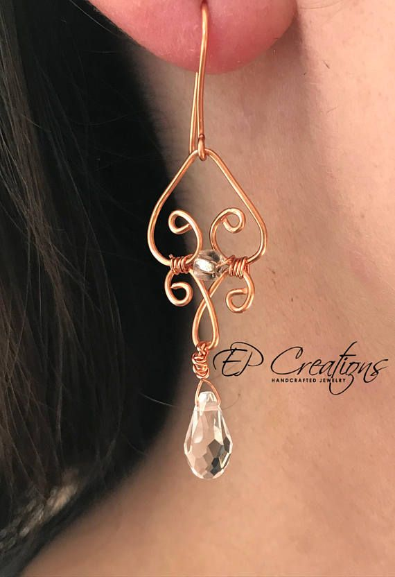 Heart-shaped dangled earrings with clear crystals Options: 1. Antique brass aluminium wire with iron, nickel-free fishhook ear-wire, brass colored 2. Aluminium copper wire with handmade aluminium ear-wire, copper colored Both options are light-weighted and yet delicate. Unique