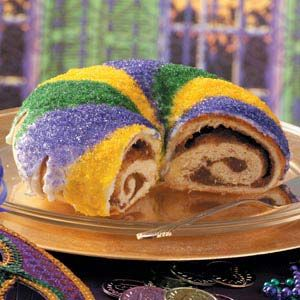 I won't be buying bakery King Cakes anymore after trying this recipe. I used cream cheese filling instead of almond but added a little almond extract to the glaze. Ridiculous good! (Buy colored sanding sugar locally at Cake Creations or make your own.)