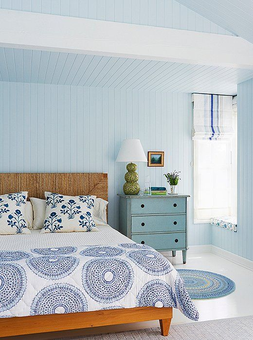 Light blue and white is such a serene, classic color palette for the bedroom.
