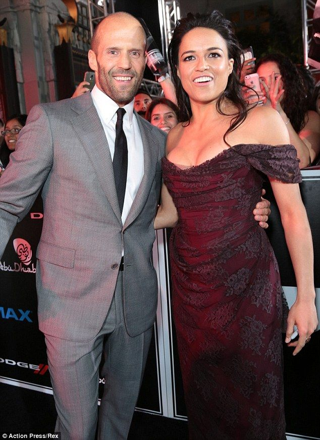 Side by side: Co-star Jason Statham joined Michelle on the red carpet...
