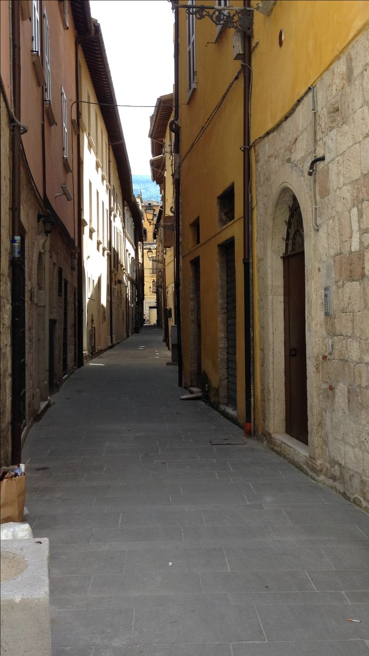 A typical, narrow, winding street in Ascoli Piceno, Le Marche, Italy.