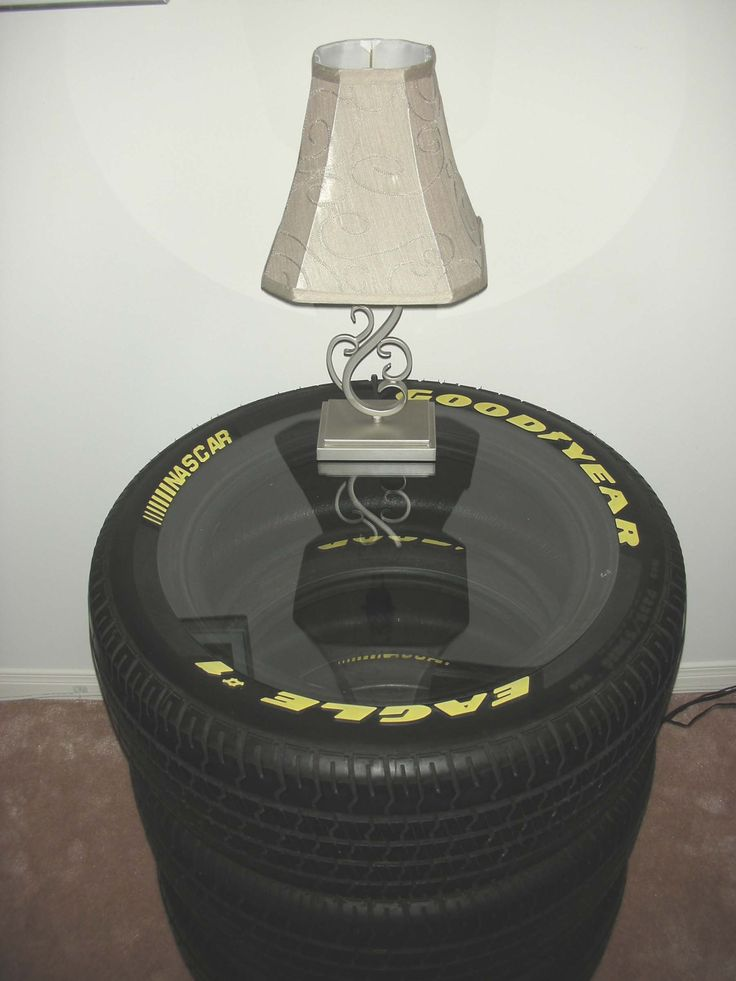 Created a sidetable from the NASCAR tires that use to be on my husband's muscle car! #paris8_can_decor8 #NASCAR Tires #side tables #man cave ideas