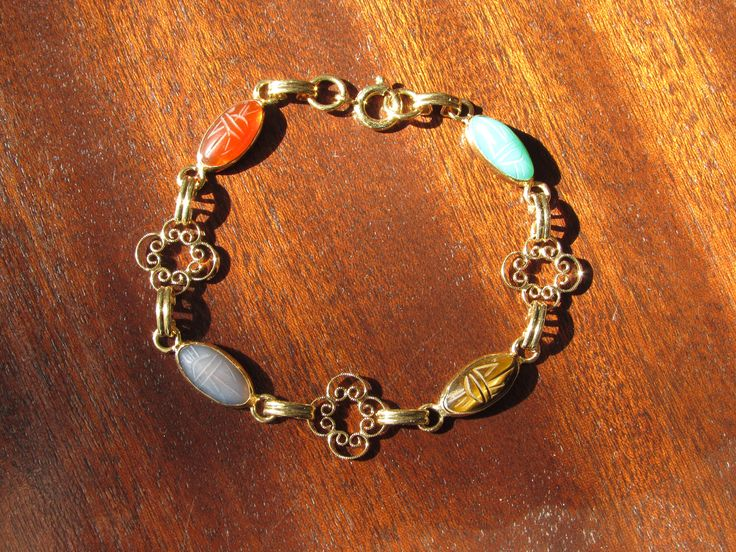Vintage Scarab Bracelet; semi-precious stones, open-back bezels; delicate, gold-tone filigree; spring clasp; larger size by CroweyeDesigns on Etsy