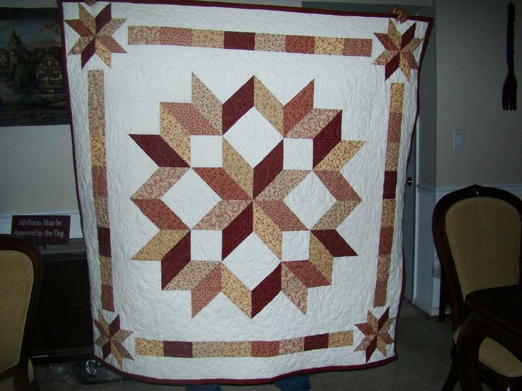 Love this version of Carpenter Star. From a post on Quilt Board.