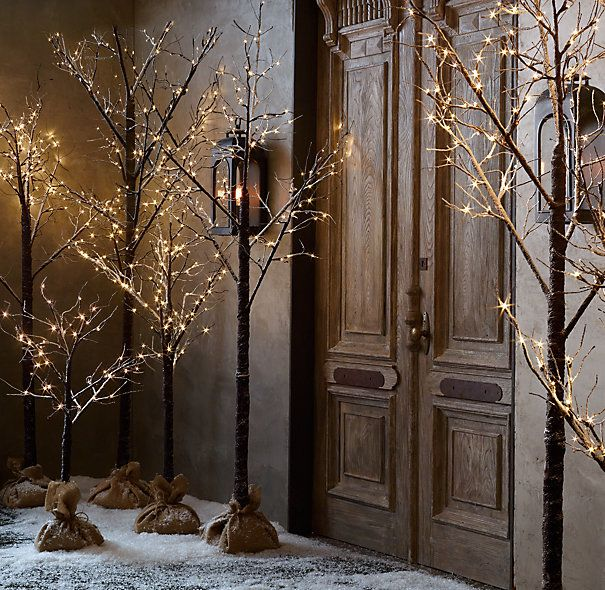 Winter Wonderland Tree - Flocked via Restoration Hardware. Cultivate a winter forest with trees that lend a magical glow to indoor and outdoor settings. The branches, wrapped in birch or dusted in snow and warm-white lights, look elegant on their own or can be strewn with garlands and ornaments.