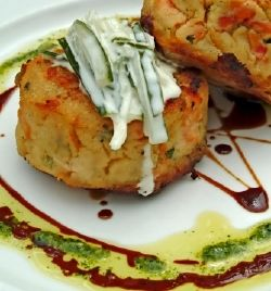RECIPES::Irish Food::Irish potato cakes  900g (2lbs) potatoes, peeled and cut into cubes   1/2 garlic clove, finely chopped   2 tablespoons of spring onions, finely sliced   100ml (0.2 pint) sour cream   1 teaspoon of mustard   Salt and freshly ground black pepper     25g (1 oz) butter, melted (if you can, skim off the solids so the butter doesn't burn)   Olive oil