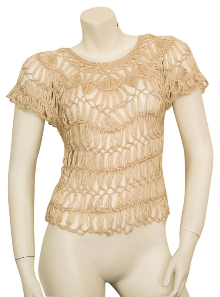 #Solitaire by Ravi Khosla #woven #crochet #knit #lace #boho #blouse #top from #Anthropologie is #NWOT. It is a #sheer, #beige top with #batwing/ #butterfly sleeves and is made out of 100% #acrylic #yarn. The yarn has no snags or pulls. The #shirt is #oversized and #loosefit and could probably accommodate a #medium comfortably. This top would look great over a #bandeau or #bralette. #cochella #hippy #hipster #hippie #bohemian #spring #summer #fall #butterflysleeve #keyholeknit #neutral