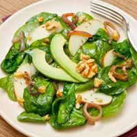 Wilted spinach salad with grilled onion, walnuts, avocado and apple