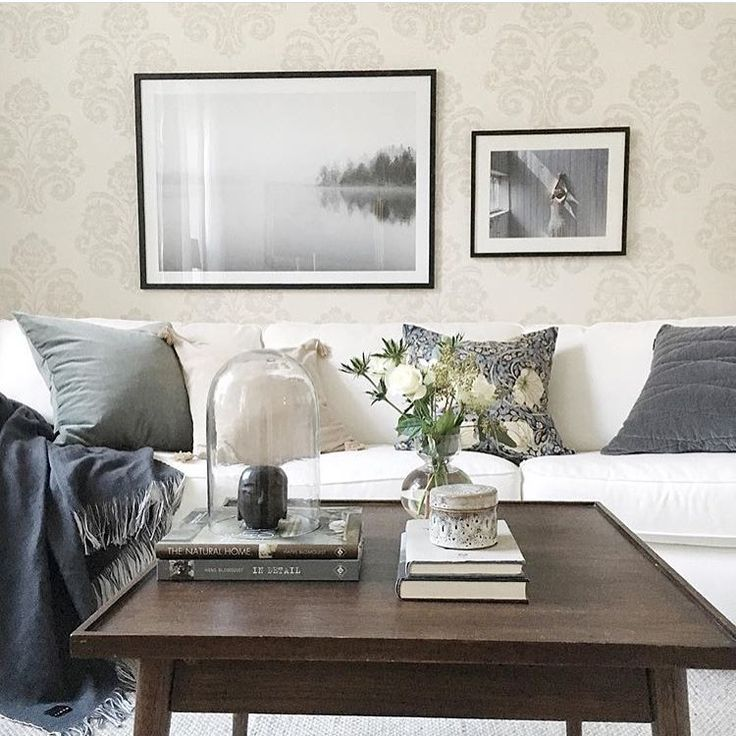 Cosy livingroom with neutral color scheme and framed posters from printler.com, the marketplace for photo art.