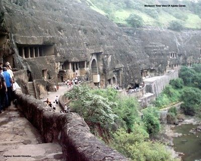 Rock-cut cave complex filled with ancient Buddhist artwork