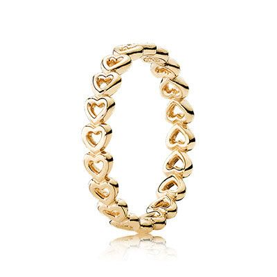 Featuring a chain of loving and delicate openwork hearts, the classy 14k gold ring is perfect for stacking and is the perfect staple piece in any collection. #PANDORA #PANDORAring